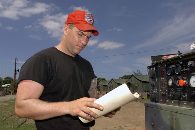 US Air Force (USAF) SENIOR AIRMAN (SRA) Brent Emel, Power Production Technician, 201st Red Horse Flight (RHF), checks the operational log on an 806-A generator, while deployed at Camp Dingo in Kingston, Jamaica, during a Joint Task Force (JTF) humanitarian mission conducted during Exercise NEW HORIZONS 2002