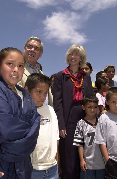 Assistant Secretary for Indian Affairs Neal McCaleb, rear left, and Secretary Gale Norton with students outside the Isleta Elementary School, Isleta, New Mexico. The school was one of several stops on Secretary's New Mexico tour highlighting federal support for American Indian schools. Photograph was usedin Interior video on Norton tenure