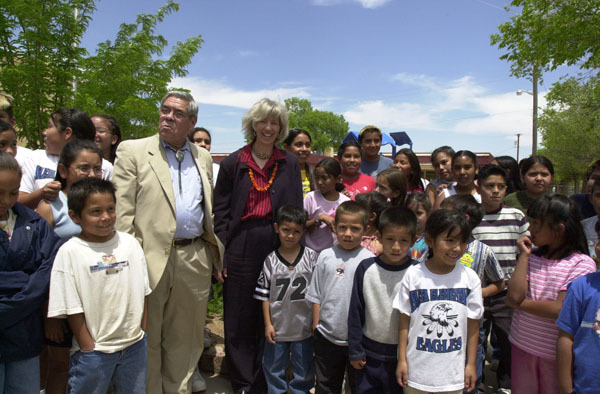 Secretary Gale Norton and Assistant Secretary for Indian Affairs Neal McCaleb joining students outside Isleta Elementary School, Isleta, New Mexico. The school, serving the Pueblo of Isleta, was one of several stops on the Secretary's New Mexico tour highlighting federal support for American Indian schools