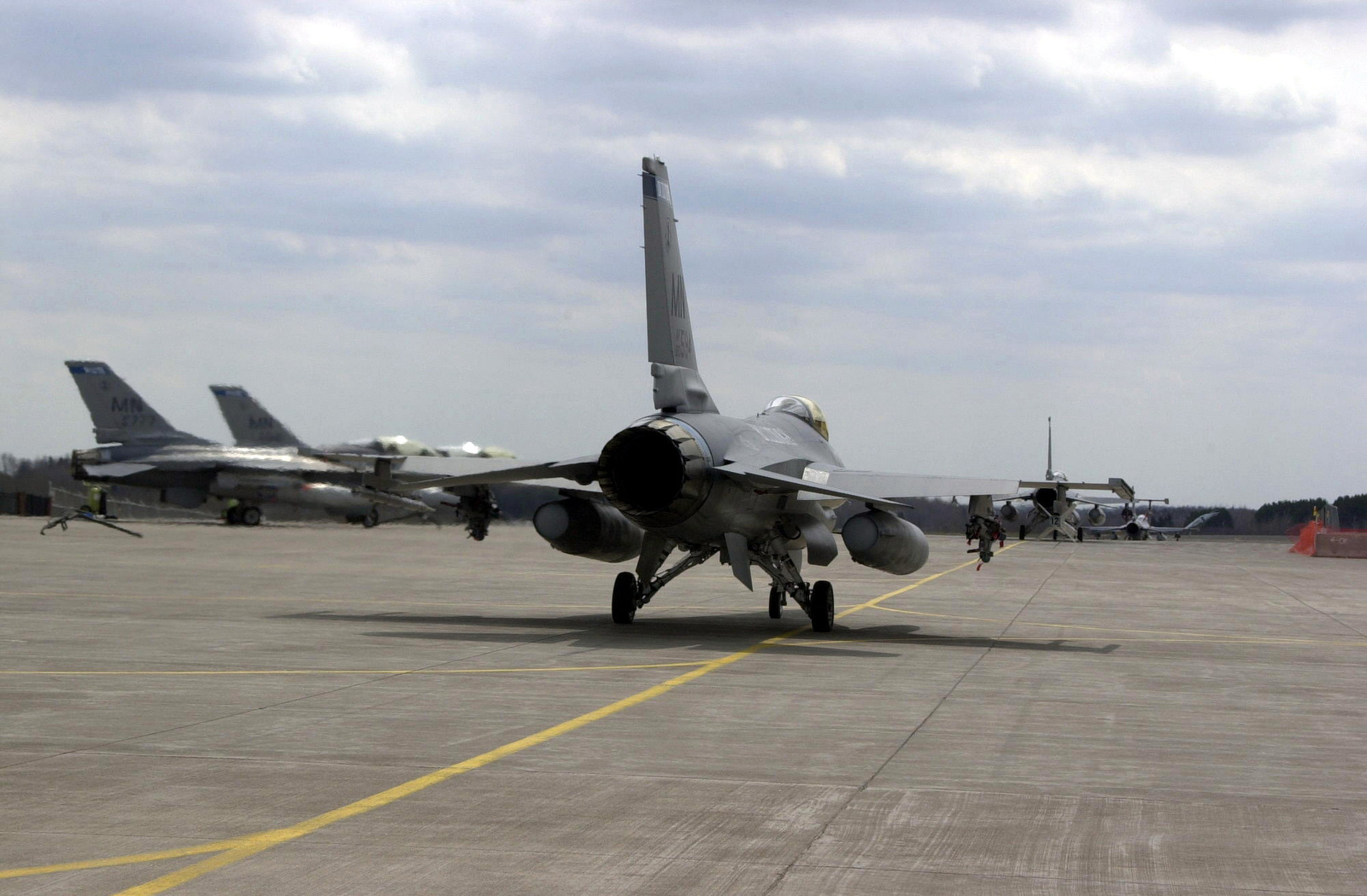 US Air Force (USAF) F-16C Fighting Falcons aircraft assigned to the 148th Fighter Wing (FW), Minnesota (MN), Air National Guard (ANG) taxi their way onto the runway at Duluth International Airport, MN, for a mission in support of Operation NOBLE EAGLE