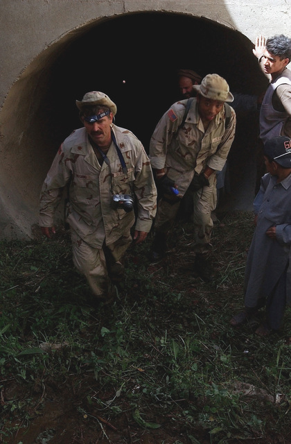 US Army (USA) Soldiers assigned to the 489th Civil Affairs Battalion, exit an irrigation aqueduct in the Matak region of Afghanistan, during Operation ENDURING FREEDOM. The irrigation system is being evaluated for build up and possible recommendation for cleaning