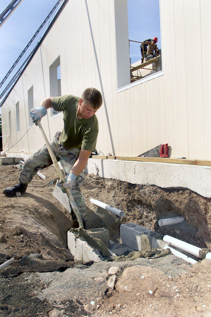 US Marine Corps (USMC) Lance Corporal (LCPL) Ronnie Jackson, Marine Wing Support Squadron 272 (MWSS-272), constructs a water trap near the foundation for the new medical clinic under construction at Camp Dingo in Kingston, Jamaica, during a Joint Task Force (JTF) humanitarian mission conducted during Exercise NEW HORIZONS 2002