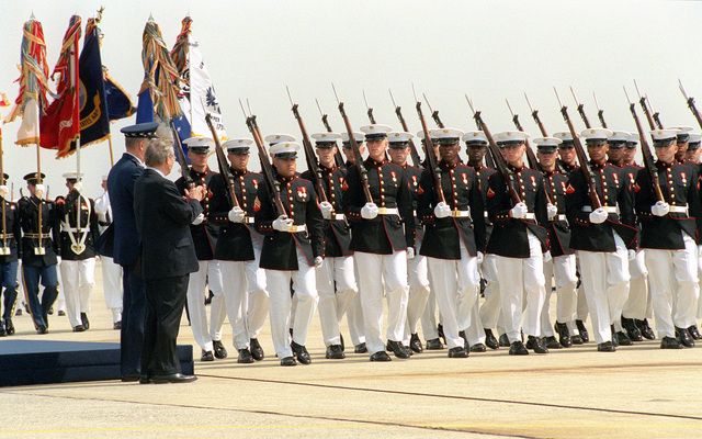 Chairman of the Joint Chiefs of STAFF, US Air Force (USAF) General (GEN) Richard B. Myers (left), and US Secretary of Defense (SECDEF), The Honorable Donald H. Rumsfeld, applaud as the US Marine Corps (USMC) Honor Guard passes in review, during a Joint Service Open House Ceremony held at Andrews Air Forces Base (AFB), Maryland (MD)