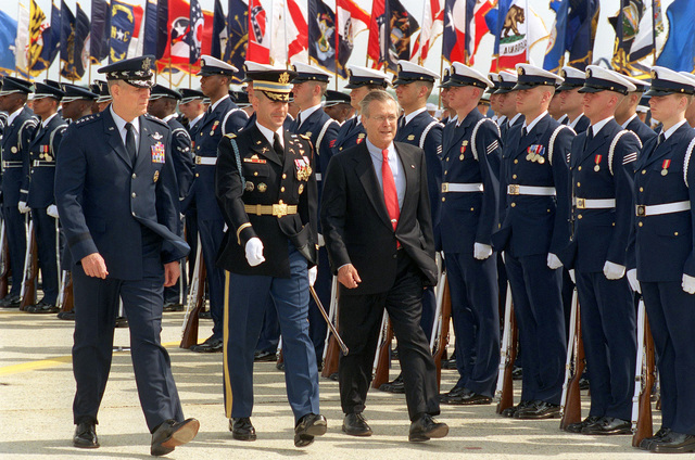 Chairman of the Joint Chiefs of STAFF, US Air Force (USAF) General (GEN) Richard B. Myers (left), Commander of Troops, US Army (USA) Colonel (COL) James F. Laufenberg (center), and US Secretary of Defense (SECDEF), The Honorable Donald H. Rumsfeld, review the Troops during a Joint Service Open House Ceremony at Andrews Air Forces Base (AFB), Maryland (MD)