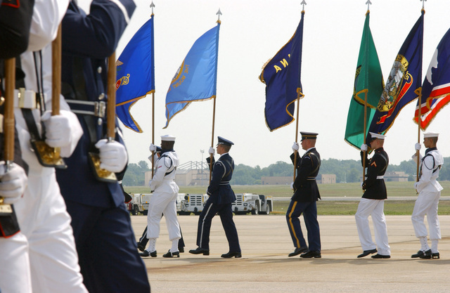 Members of a US Military Joint Service Color Guard participate in the honorary pass and review during the Joint Services Open House Ceremony, held at Andrews Air Force Base (AFB) Maryland (MD)