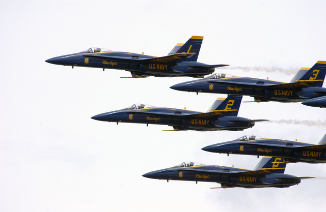 The US Navy (USN) Blue Angels F/A-18C Hornet aerial demonstration team aircraft perform during the Joint Services Open House Ceremony, held at Andrews Air Force Base (AFB) Maryland (MD)