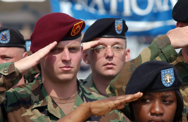 US Air Force (USAF) and US Army (USA) Security Personnel render salutes during the Joint Services Open House Ceremony, held at Andrews Air Force Base (AFB) Maryland (MD)