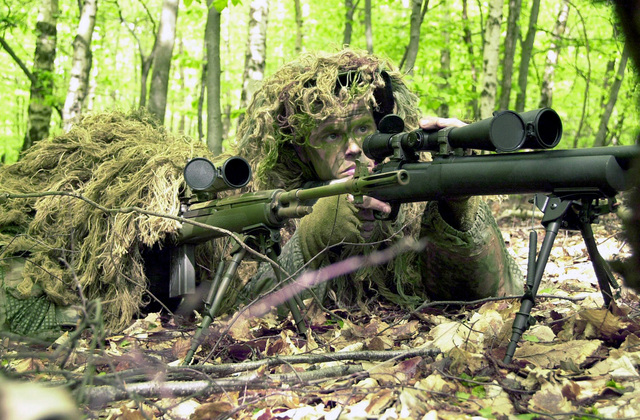 US Air Force (USAF) STAFF Sergeant (SSGT) Ace Jones (left) mans a 7.62mm Springfield Armory M21 Sniping rifle, while USAF SSGT Larry Knoll sites through the scope of his 7.62mm M24 Sniper rifle, both are participating in marksmen ship training at the US Army (USA) Sniper Scholl at Sembach Army Annex, Germany