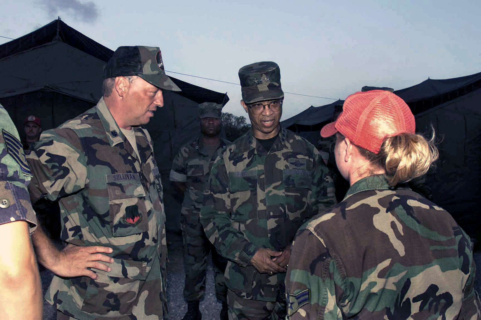 US Air Force (USAF) Lieutenant General (LGEN) Russell Davis (center) CHIEF, National Guard Bureau, is accompanied by USAF Lieutenant Colonel (LTC) Frank Sullivan (left), Company Commander (CC) Joint Task Force (JTF) Blue Mountain, as he speaks with USAF AIRMAN First Class (A1C) Amanda Rosato, Engineering Assistant, 200th Red Horse Flight (RHF), during his visit to Camp Dingo in Kingston, Jamaica, to visit with Joint Task Force (JTF) personnel during Exercise NEW HORIZONS 2002