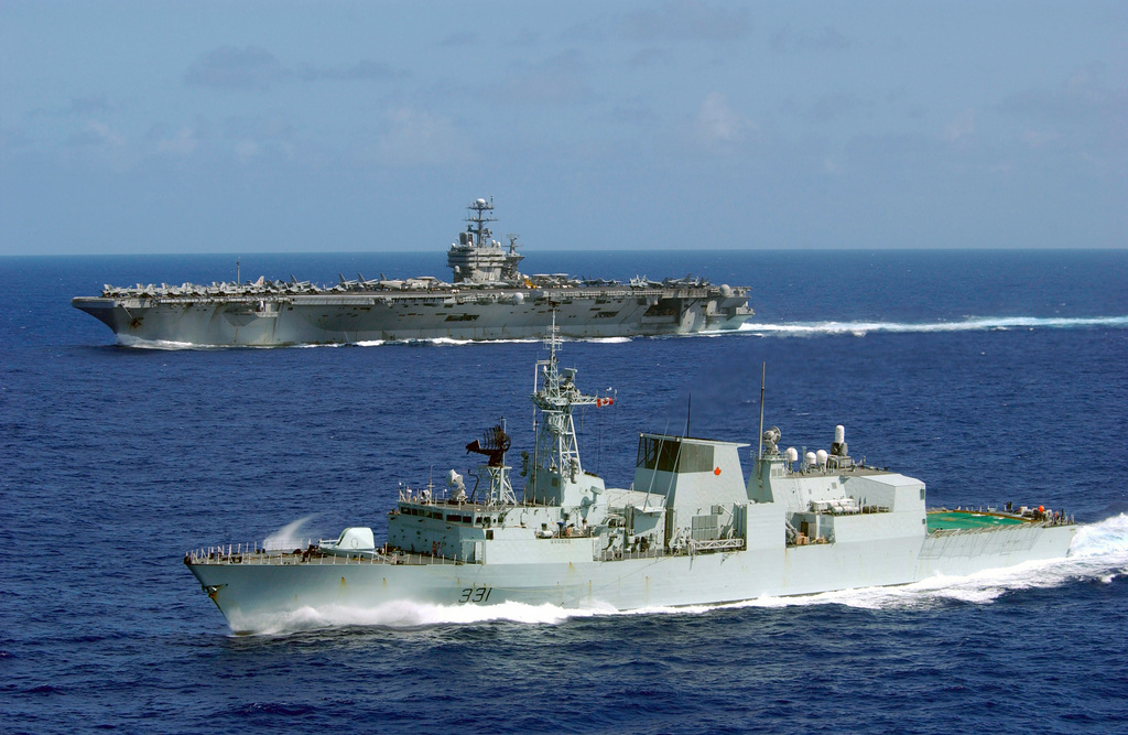 Canadian HALIFAX class Patrol Frigate HMCS VANCOUVER (FFH 331) steams along side the NIMITZ class Aircraft Carrier USS JOHN C. STENNIS (CVN 74) as ships from the JOHN C. STENNIS Battle Group return from an extended deployment in support of Operation ENDURING FREEDOM. The battle group deployed November 2001, two months ahead of its scheduled date after the September 11th terrorist attacks