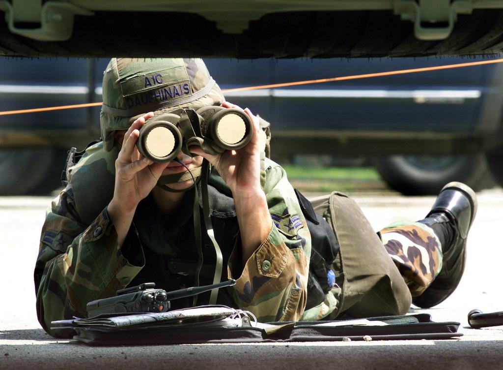US Air Force (USAF) SENIOR AIRMAN (SRA) Wayne Dauphinais, 51st Civil Engineer Squadron (CES), uses a pair of binoculars to surveys for Unexploded Ordnance (UXO), during Exercise BEVERLY BULLDOG 02-02, at Osan Air Base (AB) Korea