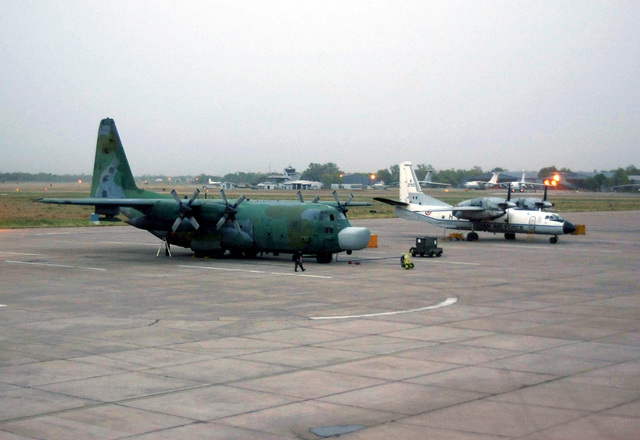 A US Air Force (USAF) MC-130H Combat Talon II aircraft assigned to the 1ST Special Operations Squadron, 353rd Special Operations Group (SOG), is parked on the flight pad at Air Force Station Agra, India. An Indian Air Force AN-32 Cline aircraft is parked to its right