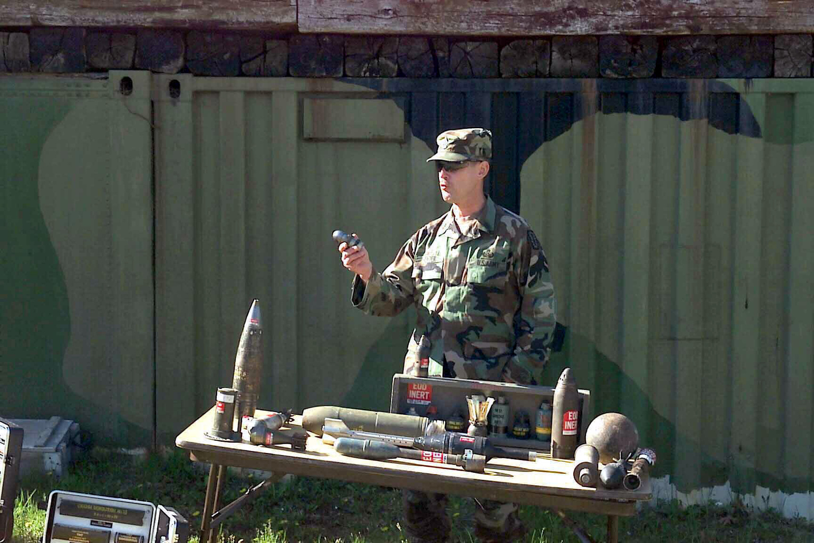 During a demolition exercise at Range 17a, First Sergeant (1SG) Donald Vender, USA, 788th Ordnance Company, Explosive Ordnance Disposal (EOD), presents some of the explosives found at private residences to the media