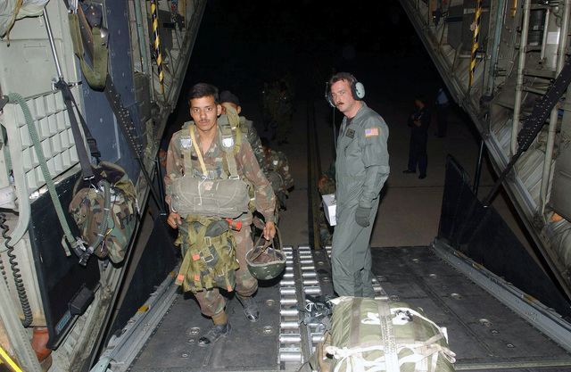 US Air Force (USAF) STAFF Sergeant John Tubbs (right), an MC-130H Combat Talon II aircraft Loadmaster assigned to the 1ST Special Operations Squadron (SOS), watches Indian Army paratroopers load into his aircraft. SSGT Tubbs and USAF personnel assigned to the 353rd Special Operations Group are (SOG) deployed for joint combined exchange training with the Indian Armed Forces, at Air Force Station Agra, India