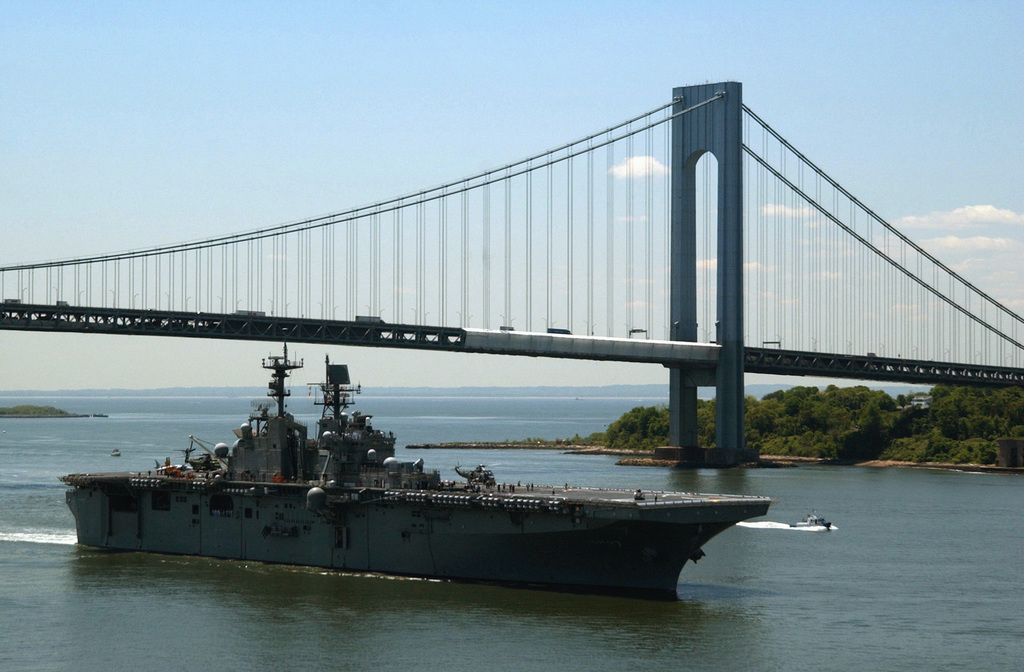 The multi-purpose WASP class Amphibious Assault Ship USS IWO JIMA (LHD 7) passes under the Verrazano-Narrows Bridge as it makes it's way up the Hudson River to kick off Fleet Week 2002. More than 6000 Sailors, Marines and Coast Guard personnel aboard 22 ships - including six warships returning from deployment in support of Operation Enduring Freedom, the war against terrorism - sailed into New York today for the 15th Annual Fleet Week 2002