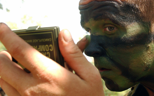 US Army (USA) Sergeant (SGT) Julian Zamarripa, Infantryman, 1ST Battalion, 27th Infantry Regiment, applies camouflage face paint during jungle survival training held in Thailand, during Exercise COBRA GOLD 2002