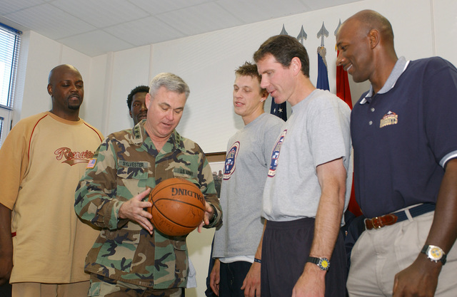 Members of the National Basketball Association (NBA) Denver Nuggets franchise, present US Army (USA) Lieutenant General (LGEN) John B Sylvester (center), Commander, Stabilization Force (SFOR), with an autographed basketball during a Goodwill tour to Bosnia and Herzegovina, to show support for US Military personnel in the European theatre during Operation JOINT FORGE. Pictured left-to-right are players George McCloud; Donnell Harvey; Chris Andersen; along with General Manager Kiki Vandeweghe and Assistant Coach Clyde Drexler