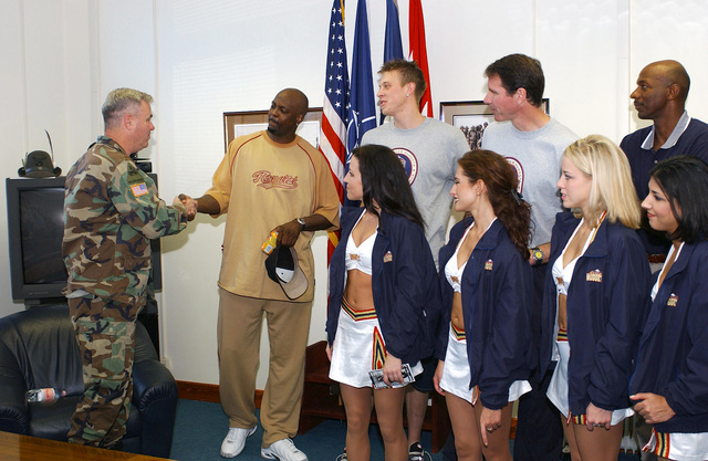 Members of the National Basketball Association (NBA) Denver Nuggets franchise meet US Army (USA) Lieutenant General (LGEN) John B Sylvester (left), Commander, Stabilization Force (SFOR), during a Goodwill tour to Bosnia and Herzegovina, to show support for US Military personnel in the European theatre during Operation JOINT FORGE. Pictured left-to-right back row are players George McCloud and Chris Andersen along with General Manager Kiki Vandeweghe and Assistant Coach Clyde Drexler. Also pictured are members of the Nuggets Dancers