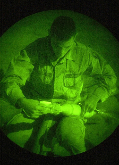 Light enhanced photography showing a US Army (USA) Soldiers assigned to the mortar section of 2nd Battalion, 187th Infantry, 101st Airborne Division, setting the timer on a 81mm mortar round while providing security at Forward Operating Base (FOB) 31 near Kabul, Afghanistan, during Operation ENDURING FREEDOM