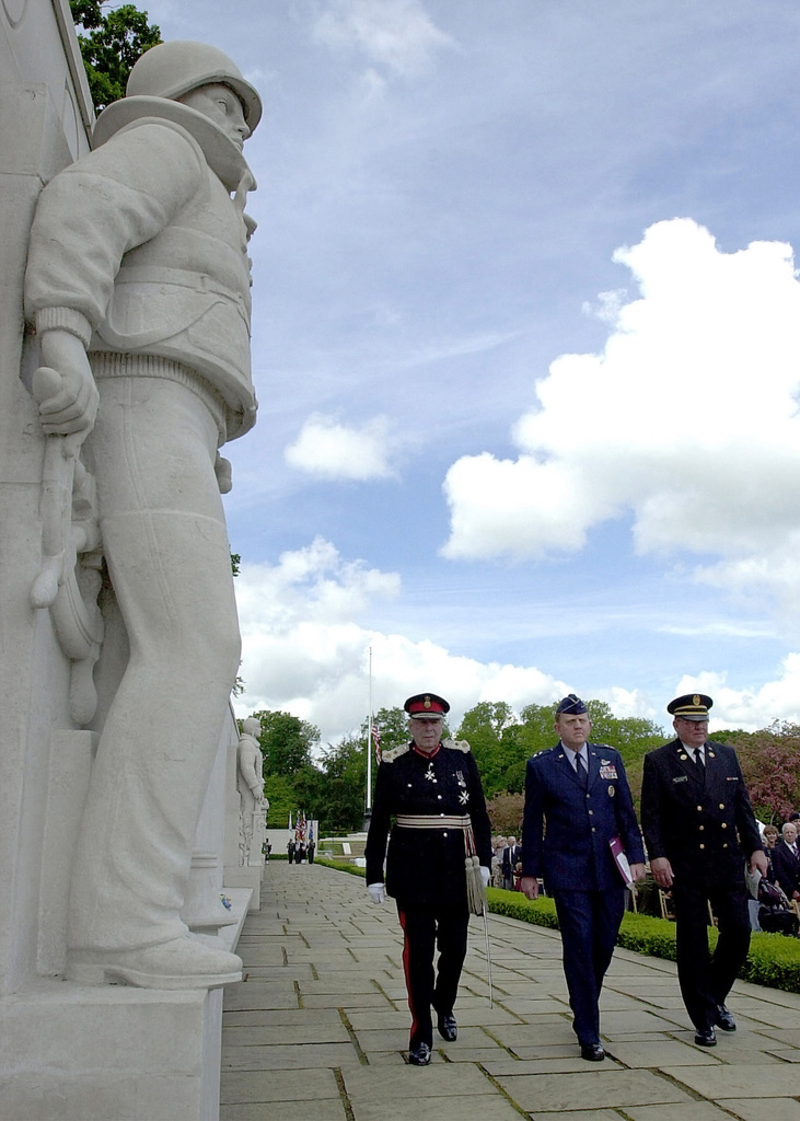 Her Majesty's Lord Lieutenant of Cambridgeshire, Mr. James G. P. Crowden (left), US Air Force (USAF) Major General (MGEN) Kenneth W. Hess, Commander, 3rd Air Force, and Mr. James Schoenecker, Superintendent, Cambridge American Military Cemetery, National Monuments Commission, walk down The Wall of the Missing during Memorial Day Services at the Cambridge American Military Cemetery in Cambridgeshire, United Kingdom (UK)