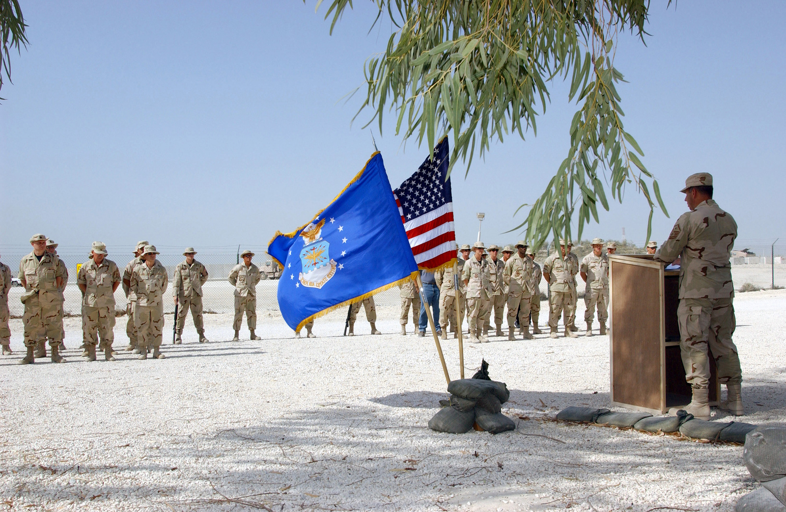 US Air Force (USAF) MASTER Sergeant (MSGT) Thomas Tezel, First Sergeant for the 384th Air Expeditionary Group (AEG), speaks during a Memorial Day Service for members of the 438th AEG deployed at an undisclosed location during Operation ENDURING FREEDOM
