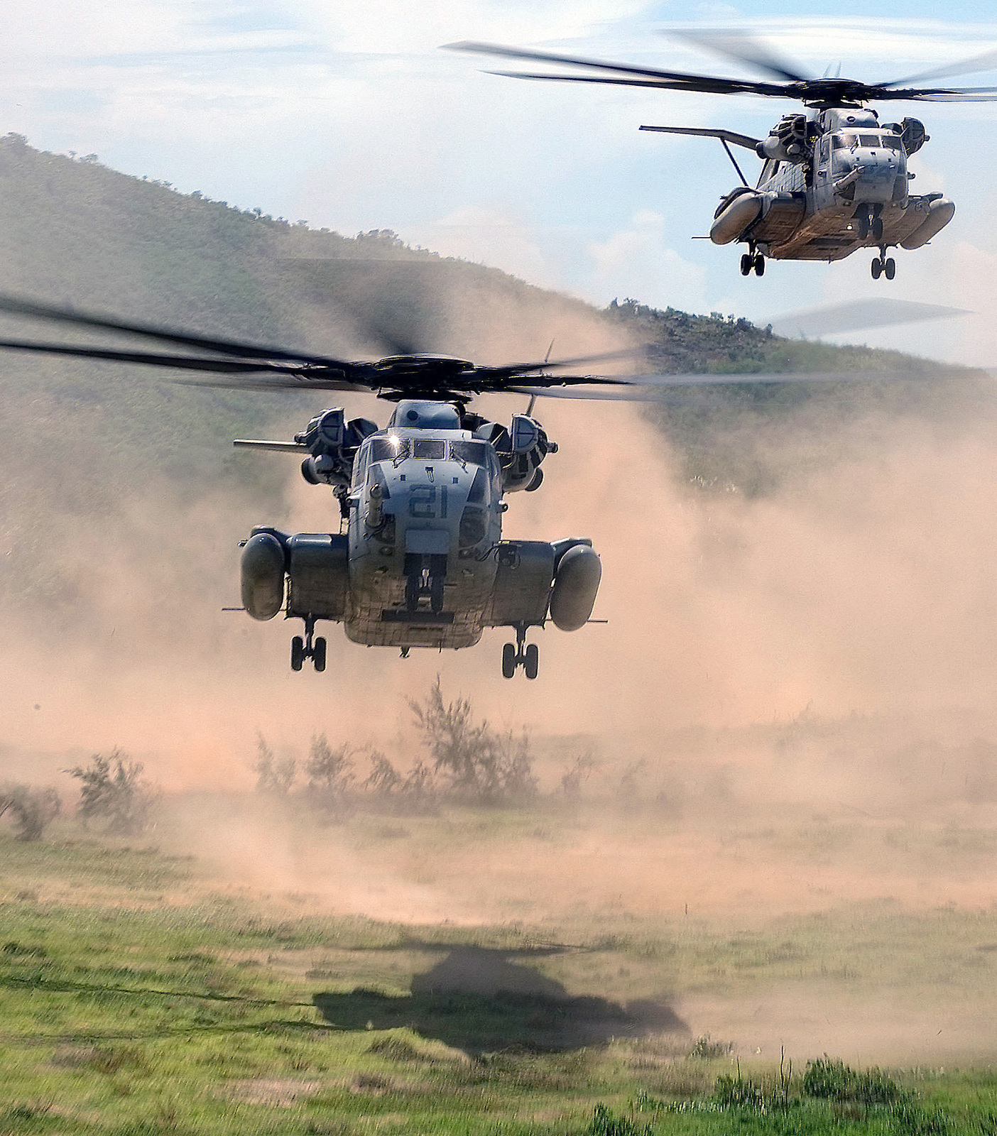 Two US Marine Corps (USMC) CH-53E Sea Stallion helicopters