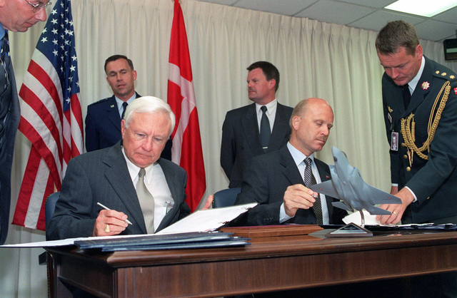 US Under Secretary of Defense for Acquisition, Technology, and Logistics, The Honorable Edward C. Aldridge (seated left) and Kingdom of Denmark, Deputy Permanent Secretary of State for Defense and National Armaments Director, Jorgen Hansen-Nord (seated right), sign a memorandum of understanding during a meeting conducted inside the Pentagon in Washington, District of Columbia (DC)