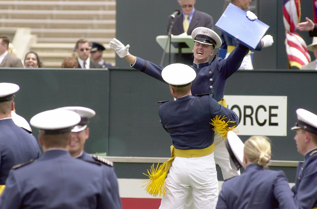 Two US Air Force Academy Class of 2002 Cadets rejoice during the graduation ceremony held at Falcon Stadium, Colorado Springs, Colorado (CO)