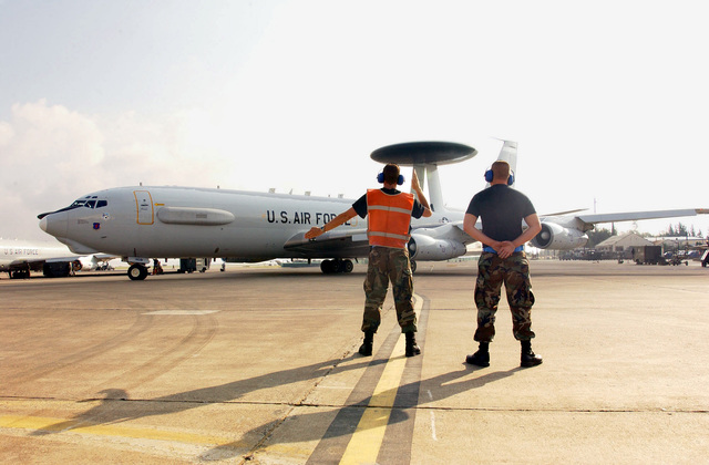 US Air Force (USAF) AIRMAN First Class (A1C) John Gill (left) and USAF A1C David Heaps, both assigned to the 552nd Aircraft Generation Squadron (AGS), prepare to launch a USAF E-3A Sentry Airborne Warning and Control System (AWACS) aircraft, while deployed at Incirlik Air Base (AB), Turkey