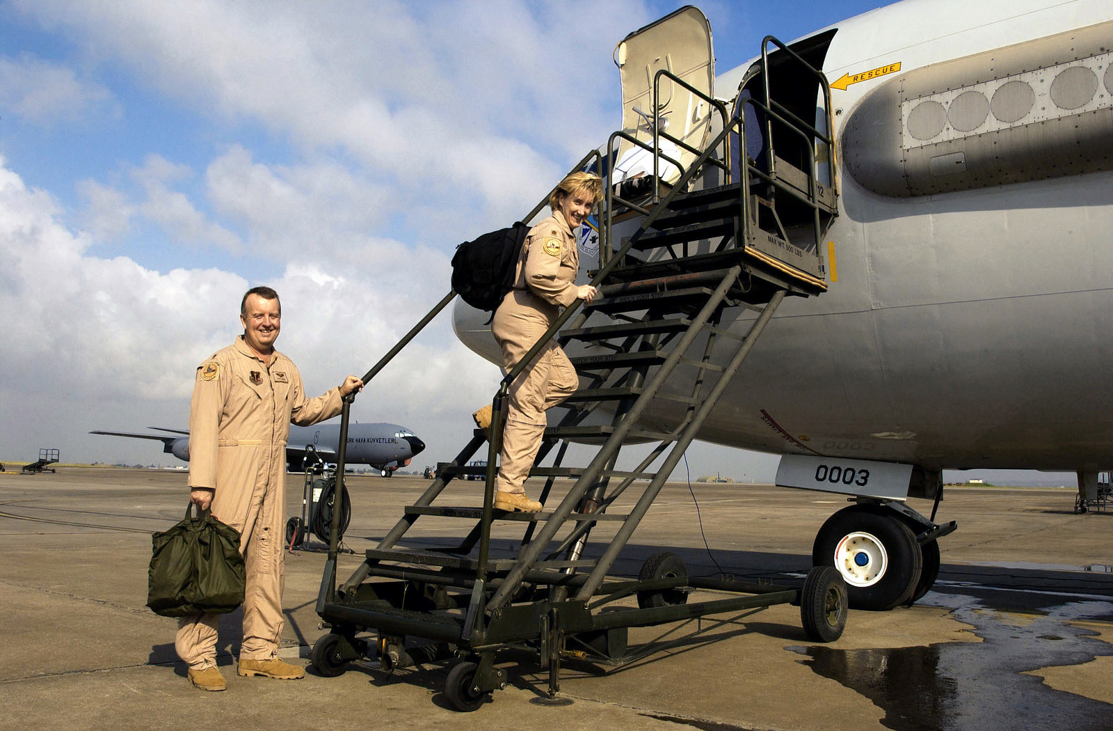 US Air Force (USAF) Major (MAJ) Chuck Diven and USAF MAJ Julie Kruse, E-3A Sentry Airborne Warning and Control System (AWACS) aircraft Pilots assigned to the 970th Expeditionary Air Borne Control Squadron, board their aircraft to perform pre-flight inspections before launch a mission from Incirlik Air Base (AB), Turkey