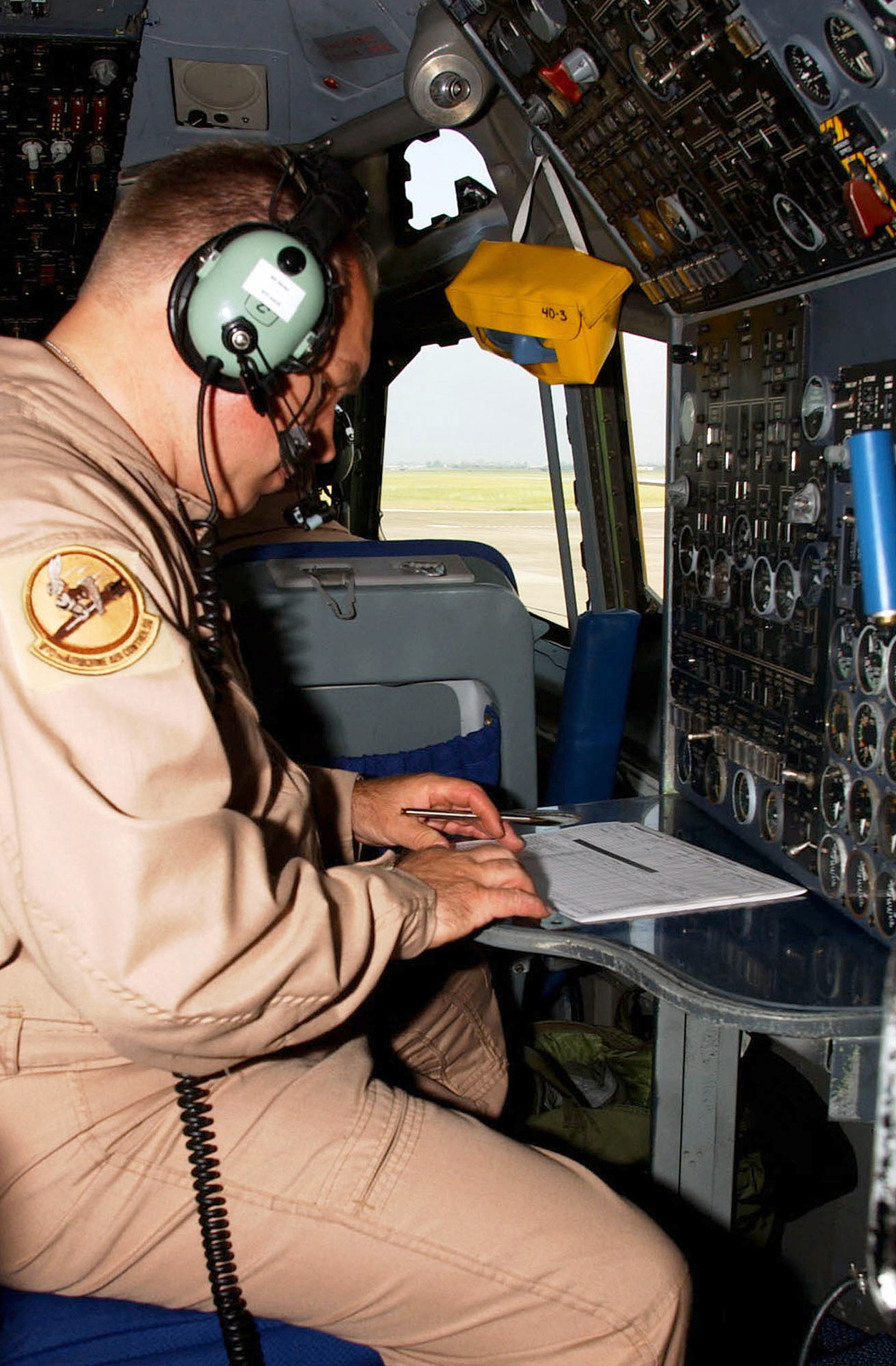 US Air Force (USAF) SENIOR MASTER Sergeant (SMSGT) William Gates, a Flight Engineer assigned to the 970th Expeditionary Air Borne Control Squadron, performs a system check at his station aboard a USAF E-3A Sentry Airborne Warning and Control System (AWACS) aircraft, while deployed at Incirlik Air Base (AB), Turkey