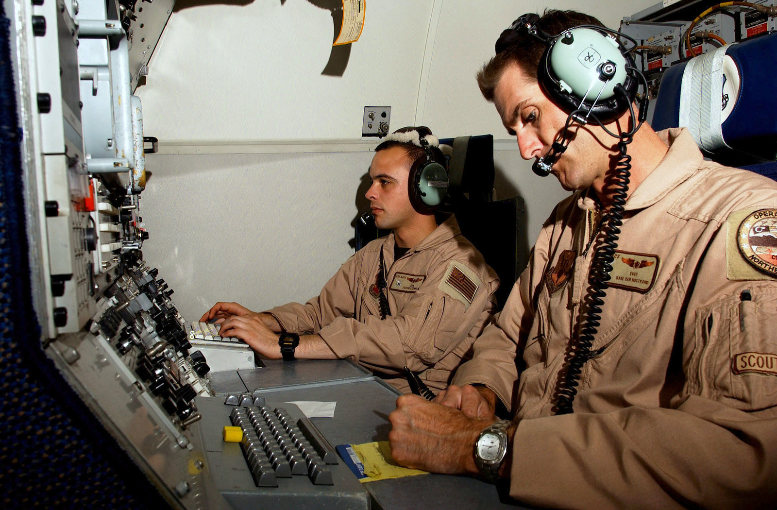 US Air Force (USAF) STAFF Sergeant (SSGT) Dave Van Nostrand (foreground) and USAF SENIOR AIRMAN (SRA) Jason Strayer, both assigned to the 970th Expeditionary Air Borne Control Squadron, perform pre-flight inspection on the communications system aboard a USAF E-3A Sentry Airborne Warning and Control System (AWACS) aircraft, while deployed at Incirlik Air Base (AB), Turkey
