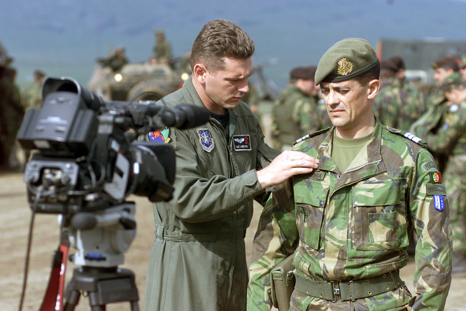 US Air Force (USAF) Technical Sergeant (TSGT) James Monk (left), a Videographer assigned to the 30th Communications Squadron (CS), prepares to document a videotape interview with Portuguese Army Lieutenant Colonel (LTC) Isidro De Morais Pereira, Commander, 2nd Armored Infantry Battalion, at the conclusion of Exercise LIBERIAN RESOLVE, held at the Glamoc live-fire range, Camp Butmir, Bosnia and Herzegovina