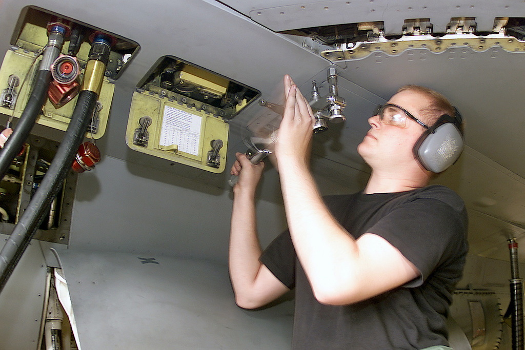 US Air Force (USAF) AIRMAN First Class (A1C) James Imler, Tactical Aircraft Maintenance SPECIALIST Journeyman, removes the leading-edge flap seals on a USAF F-16 Fighting Falcon aircraft during a scheduled 300-flight hours phase maintenance inspection conducted at Aviano Air Base (AB) Italy