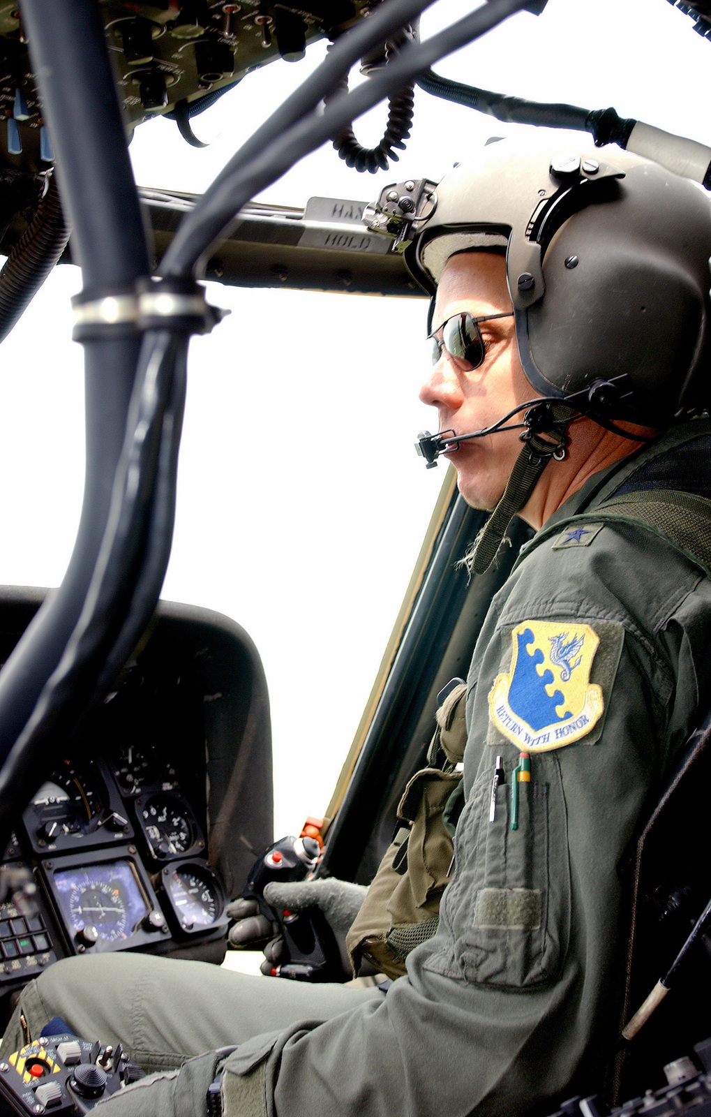 US Air Force (USAF) Brigadier General (BGEN) Don Hoffman, Commander, 31st Fighter Wing (FW), pilots a US Army (USA) UH-60 Black Hawk helicopter during an incentive flight conducted from Aviano Air Base (AB), Italy