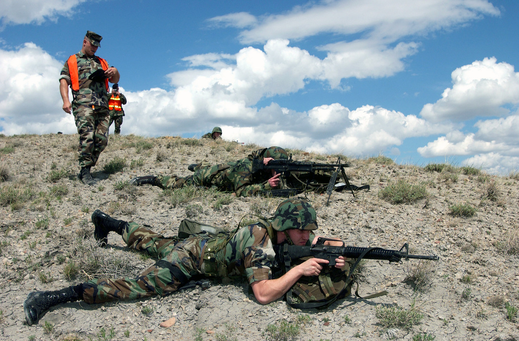 An Exercise Evaluator inspects US Air Force (USAF) Security Police (SP) assigned to the 341st Space Wing (SW) armed with a 5.56mm M16A2 rifle and a 7.62mm M-60 general purpose machine gun, as they provide fire line protection outside of location Hotel 2, during the Launch Facility (LF) Recapture portion of the Nuclear Surety Inspection (NSI) Exercise, at Malmstrom Air Force Base (AFB), Montana (MT)
