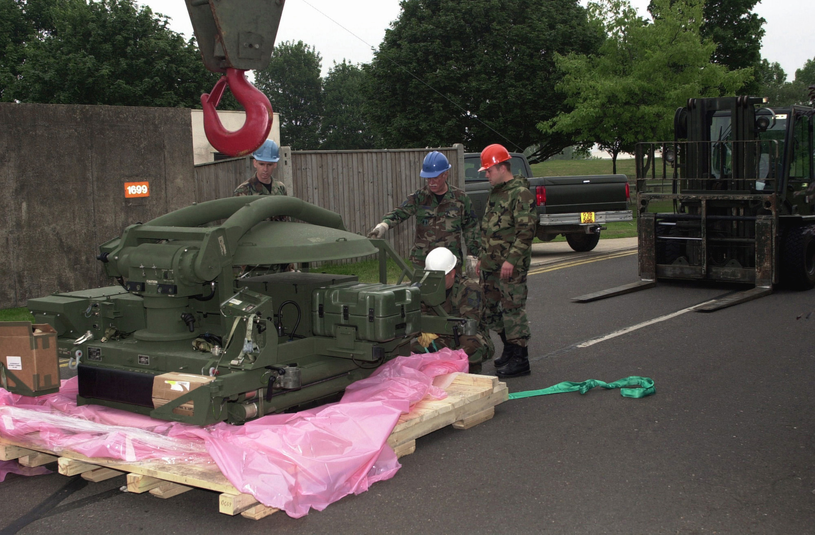 US Air Force (USAF) and Air National Guard (ANG) personnel assigned to the100th Civil Engineering Squadron (CES), review the Secure Mobile Anti-jam Reliable Tactical (SMART) Satellite Terminal equipment during initial installation at Royal Air Force (RAF) Mildenhall, United Kingdom (UK). Shown are USAF MASTER Sergeant (MSGT) Paxton (left), Louisiana (LA) ANG; MSGT Ron Morris, Ohio (OH) ANG; STAFF Sergeant (SSGT) Deacon White, 100th CES; and SSGT Andy Franks 100th CES