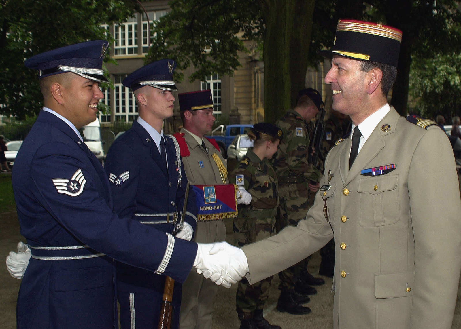 An unidentified French Army Officer (right) shakes hand with US Air Force (USAF) Airmen assigned to the Base Honor Guard Team at Ramstein Air Base (AB), Germany, in appreciation for their participation during a French Veterans Organization Ceremony held at Metz-Sablon, France