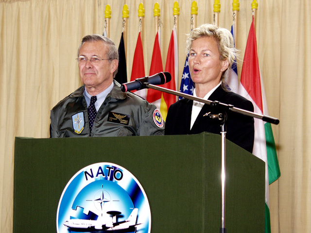 Norwegian Minister of Defense Mrs. Kristin Krohn Devold (at lectern) and U.S. Secretary of Defense The Honorable Donald H. Rumsfeld, address the audience during an awards ceremony for the NATO E-3A AWACS Component at Geinlenkirchen Air Base, Germany, on June 7, 2002. During his visit the Secretary expressed the Nation's thanks for the effort the Component contributed in providing airspace security over the United States after the attacks of Sept. 11th, 2001. (NATO photo by MASTER SGT. Stefan Miller) (Released)