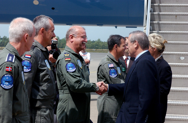 Ranking Military Officers from Norway, The Netherlands, Germany and the U.S., assigned to the NATO Force Command, E-3A Component at Geinlenkirchen Air Base, Germany, greet U.S. Secretary of Defense The Honorable Donald H. Rumsfeld and Norwegian Minister of Defense Mrs. Kristin Krohn Devold, as they arrive on June 7, 2002. The Secretary expressed the Nation's thanks for the efforts the Component contributed in providing airspace security over the United States after the attacks of Sept. 11th, 2001. (NATO photo by MASTER SGT. Chadwick Eiring) (Released)