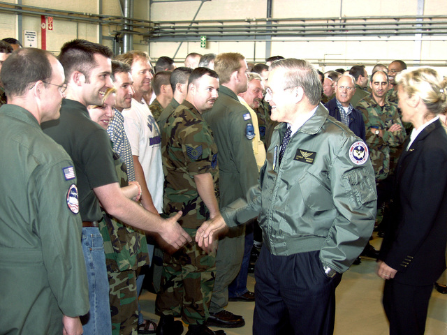 The Honorable Donald H. Rumsfeld, U.S. Secretary of Defense, (center), takes time out to greet personnel assigned to the NATO E-3A AWACS Component at Geinlenkirchen Air Base, Germany, on June 7, 2002. During his visit the Secretary expressed the Nation's thanks for the efforts the Component contributed in providing airspace security over the United States after the attacks of Sept. 11th, 2001. He also awarded the Component the Joint Meritorious Unit Award for their contributions. Accompanying the Secretary is Norwegian Minister of Defense Mrs. Kristin Krohn Devold (right). (NATO photo by MASTER SGT. Stefan Miller) (Released)