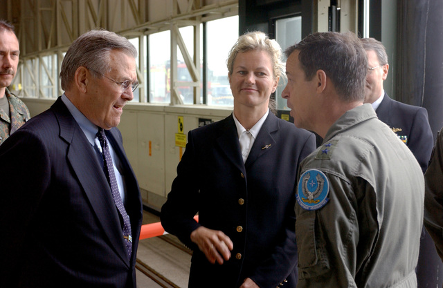 U.S. Air Force MAJ. GEN. Gary Winterberger (foreground), E-3A Component Commander, talks with U.S. Secretary of Defense The Honorable Donald H. Rumsfeld (left), as he arrive at Geilenkirchen Air Base, Germany, June 7, 2002. Accompanying the Secretary is Norwegian Minister of Defense Mrs. Kristin Krohn Devold (center). During his visit the Secretary expressed the Nation's thanks for the efforts the Component contributed in providing airspace security over the United States after the attacks of Sept. 11th, 2001. (NATO photo by MASTER SGT. Chadwick Eiring) (Released)
