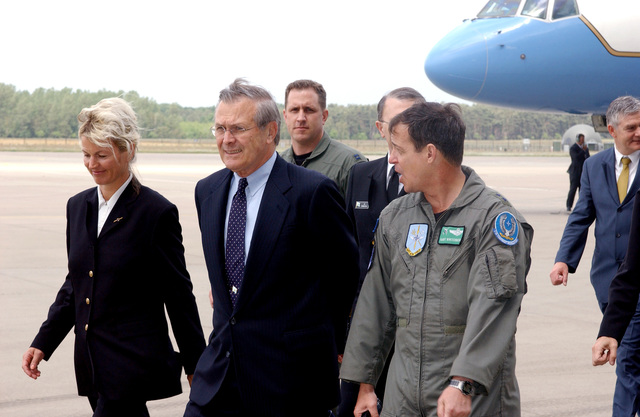 U.S. Air Force MAJ. GEN. Gary Winterberger (foreground), E-3A Component Commander, talks with U.S. Secretary of Defense The Honorable Donald H. Rumsfeld (center), as he arrive at Geilenkirchen Air Base, Germany, June 7, 2002. Accompanying the Secretary is Norwegian Minister of Defense Mrs. Kristin Krohn Devold (right). During his visit the Secretary expressed the Nation's thanks for the efforts the Component contributed in providing airspace security over the United States after the attacks of Sept. 11th, 2001. (NATO photo by MASTER SGT. Chadwick Eiring) (Released)