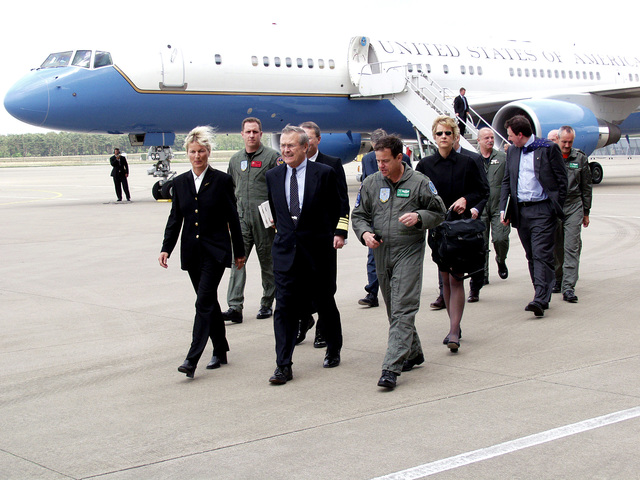U.S. Air Force MAJ. GEN. Gary Winterberger (foreground right), E-3A Component Commander, talks with U.S. Secretary of Defense The Honorable Donald H. Rumsfeld (center), as he arrive at Geilenkirchen Air Base, Germany, June 7, 2002. Accompanying the Secretary is Norwegian Minister of Defense Mrs. Kristin Krohn Devold (left). During his visit the Secretary expressed the Nation's thanks for the efforts the Component contributed in providing airspace security over the United States after the attacks of Sept. 11th, 2001. (NATO photo by MASTER SGT. Stefan Miller) (Released)