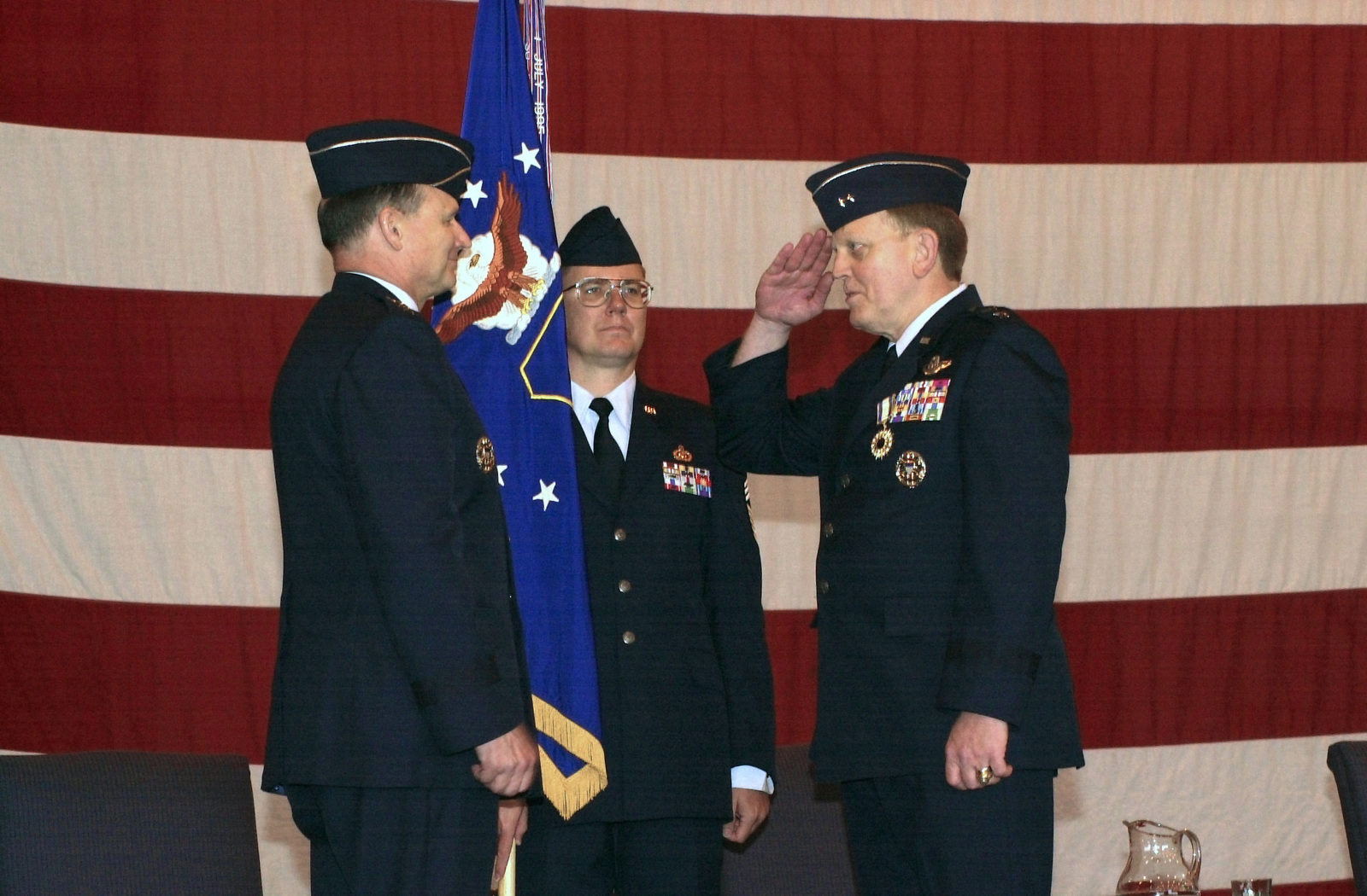 US Air Force (USAF) General (GEN) Gregory S. Martin (left), Commander, US Air Forces in Europe (USAFE), receives a salute from USAF Major General (MGEN) Major General Kenneth W. Hess, Commander, 3rd Air Force, after MGEN Hess was presented with the Distinguished Service Medal during the 3rd Air Force Change of Command Ceremony, held at Royal Air Force (RAF) Mildenhall, United Kingdom (UK)
