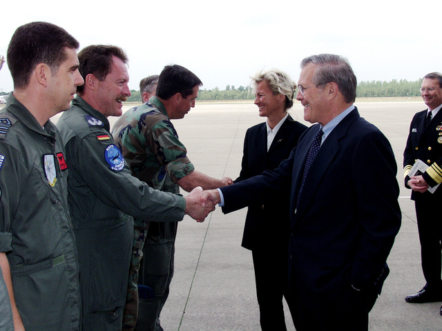 U.S. Secretary of Defense The Honorable Donald H. Rumsfeld and Norwegian Minister of Defense Mrs. Kristin Krohn Devold, are greeted by ranking military officers from Norway, The Netherlands, Germany, and the U.S., as they arrive at Geinlenkirchen Air Base, Germany, on June 7, 2002. During his visit the Secretary expressed the Nation's thanks for the efforts the Component contributed in providing airspace security over the United States after the attacks of Sept. 11th, 2001. (NATO photo by MASTER SGT. Stefan Miller) (Released)