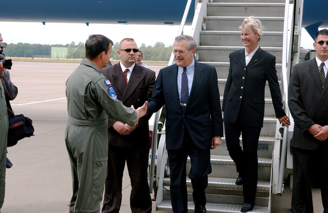 U.S. Secretary of Defense The Honorable Donald H. Rumsfeld (center), shakes hands with U.S. Air Force MAJ. GEN. Gary Winterberger, E-3A Component Commander as he arrive at Geilenkirchen Air Base, Germany, June 7, 2002. Accompanying the Secretary is Norwegian Minister of Defense Mrs. Kristin Krohn Devold. The Secretary expressed the Nation's thanks for the efforts the Component contributed in providing airspace security over the United States after the attacks of Sept. 11th, 2001. (NATO photo by MASTER SGT. Chadwick Eiring) (Released)