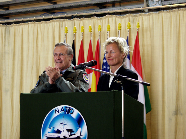 U.S. Secretary of Defense The Honorable Donald H. Rumsfeld (left) and Norwegian Minister of Defense Mrs. Kristin Krohn Devold, applaud the audience during an awards ceremony for the NATO E-3A AWACS Component at Geinlenkirchen Air Base, Germany, on June 7, 2002. During his visit the Secretary expressed the Nation's thanks for the effort the Component contributed in providing airspace security over the United States after the attacks of Sept. 11th, 2001. (NATO photo by MASTER SGT. Stefan Miller) (Released)