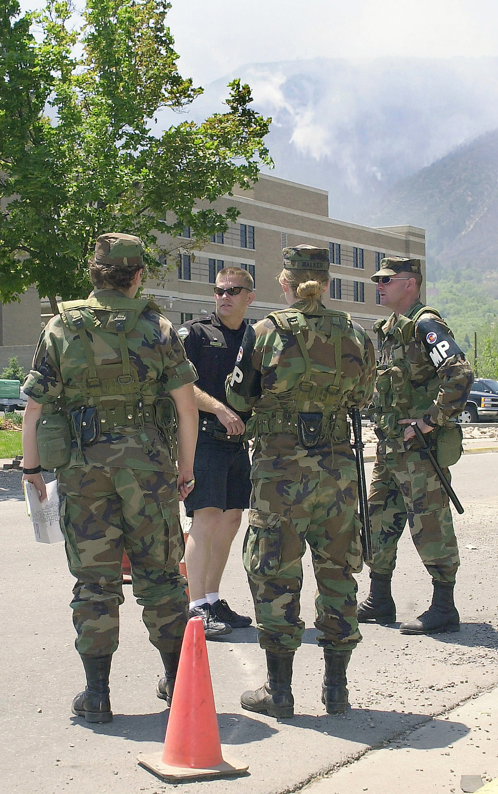 Members of the 220th Military Police (MP) Company, Colorado Army National Guard (COARNG), assist the Glenwood Springs Police Department with security access control during the Coal Seam Fires. The Coal Seam Fire started sometime in the mid-1970s as an underground fire burned along a rich vein of coal. Occassionally the fire breaks through to the surface. At this time it had burned 7,300 acres, damaged an estimated 40 structures, and caused the evacuation of 2,000 residents