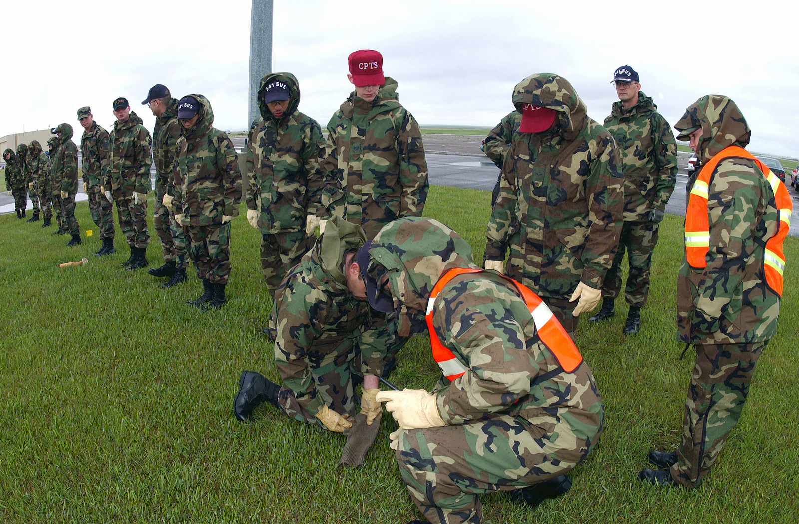 US Air Force (USAF) Airmen assigned to the 341st Services Squadron (SVS), and the 341st Comptrollers Squadron (CPTS) Search and Recovery Team, mark and collect body parts from a simulated crash scene, at Malmstrom Air Force Base (AFB), Montana (MO), during the Operational Readiness Inspection/Nuclear Surety Inspection (NSI) Exercise (ORI/NSI)